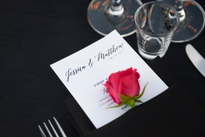 Hummingbird Nest Ranch Wedding - Place Setting with a pink rose